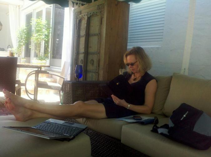 Click on the image of Marcia relaxing to book your own vacation at Villa Amarosa.